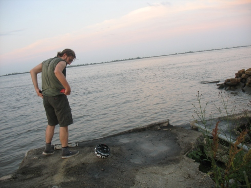 Drew makes offerings at the end of the Mississippi