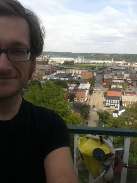 The Giant and me on the lift in Dubuque. (I also pedaled up this hill.)