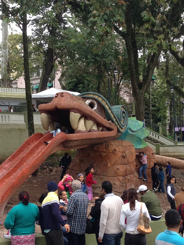 A playground in Xalapa. Yes, the dragon is a slide. Its tail winds through the whole playground and eventually becomes a jungle gym.