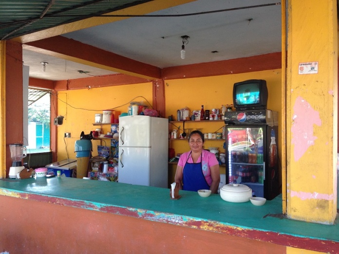 Gisela at her kiosk in Nuevo Progreso, Campeche. Photo by Andre.
