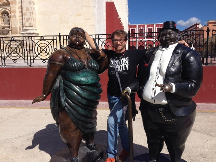 Me with statues in Campeche.